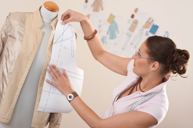 Female fashion designer working with pattern cutting